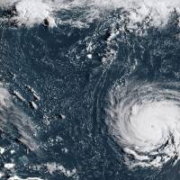 This NOAA/RAMMB satellite image taken at 12:15:31 UTC on Monday shows Hurricane Florence off the U.S. East Coast in the Atantic Ocean. Hurricane Florence, threatening the southeastern coast of the United States, strengthened Monday morning into a Category 3 'major' hurricane, the National Hurricane Center said. | LIZABETH MENZIES / NOAA/RAMMB / VIA AFP-JIJI
