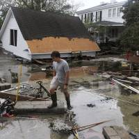Floodwaters rise, leaving at least 11 dead as Tropical Storm Florence dumps epic rain on Carolinas