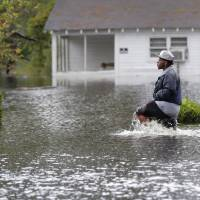 'Angry waters' as killer storm Florence floods Carolinas, cuts Wilmington off