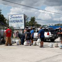 Customers line up to buy propane at Socastee Hardware store, ahead of the arrival of Hurricane Florence in Myrtle Beach, South Carolina, Monday. | REUTERS