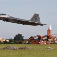 An F-22 departs Langley Air Force Base, Virginia, Tuesday morning as Hurricane Florence approaches the Eastern Seaboard. Officials from Joint Base Langley-Eustis in Hampton said the base's F-22 Raptors and T-38 Talon training jets, as a precaution, were headed for Rickenbacker Air National Guard Base in central Ohio. | JONATHON GRUENKE / THE DAILY PRESS / VIA AP