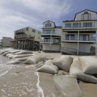 Sand bags surround homes on North Topsail Beach, North Carolina, Wednesday as Hurricane Florence threatens the coast. | AP