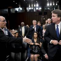 Trump Justice pick Brett Kavanaugh turns away as Parkland shooting victim's dad tries to shake his hand