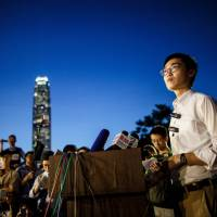 Andy Chan, leader of the pro-independence Hong Kong National Party, gives a news conference at the start of a rally near the government's headquarters in 2016. | AFP-JIJI