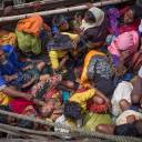 Rohingya refugees arrive by boat in September 2017 at Shah Parir Dwip, on the Bangladesh side of the Naf River, after fleeing violence in Myanmar.