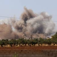 Smoke billows following Syrian government forces' bombardment around the village of al-Muntar on the southern edges of the rebel-held Idlib province on Saturday. | AFP-JIJI