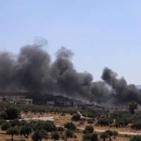 Smoke rises from buildings on fire that were hit by reported Russian airstrikes in the rebel-held town of Muhambal, about 30 km southwest of the city of Idlib, Tuesday. The United States on Wednesday urged Syria and its backers to halt plans for an all-out military attack against rebel-held Idlib as the U.N. Security Council prepared to address the crisis. 'With millions of civilians at risk, an offensive against Idlib would be a reckless escalation,' U.S. Ambassador Nikki Haley said in a statement. | AFP-JIJI