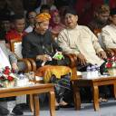 "Indonesian President Joko ""Jokowi"" Widodo (second from left) and his running mate, Ma'ruf Amin (left), talk with contender Prabowo Subianto (second from right) and his running mate, Sandiaga Uno, during a ceremony marking the start of the campaign period for next year's election in Jakarta on Sunday."