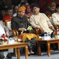 Currency woes, fake news feature as campaigning kicks off for April's Indonesian presidential election