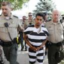 Cristhian Bahena Rivera is escorted into the Poweshiek County Courthouse for his initial court appearance in Montezuma, Iowa, Aug. 22. Rivera is charged with first-degree murder in the death of Mollie Tibbetts, who disappeared July 18 from Brooklyn, Iowa. Rivera pleaded not guilty during a court appearance Wednesday.