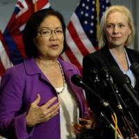 U.S. Sen. Mazie Hirono (D-HI) speaks at a news conference with Sen. Kirsten Gillibrand (D-NY) as they introduce Holton-Arms high school graduates to release a letter from more than a thousand graduates of the school supporting professor Christine Blasey Ford and their belief in her accusations against President Donald Trump's U.S. Supreme Court nominee, Brett Kavanaugh, on Capitol Hill in Washington Thursday. | REUTERS