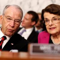 U.S. Sens. Chuck Grassley (R-IA) and Dianne Feinstein (D-CA) talk together during U.S. Supreme Court nominee Judge Brett Kavanaugh's U.S. Senate Judiciary Committee confirmation hearing on Capitol Hill in Washington Wednesday. | REUTERS