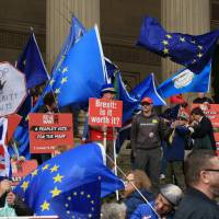 People protest against Brexit at St. Georges Plateau in Liverpool during the Labour Party's annual conference | AP