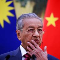 Malaysia's Prime Minister Mahathir Mohamad speaks during a news conference at the Great Hall of the People in Beijing last month. | POOL / VIA REUTERS