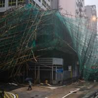 Massive cleanup in Hong Kong after typhoon brings trail of destruction