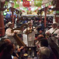 A 'jarocho' band plays in the Salon Tenampa restaurant in Garibaldi Plaza in Mexico City on Wednesday. At the Tenampa, which bills itself as having first brought mariachi troupes to the plaza in the 1920s, a manager said it was business as usual Saturday despite a brazen Friday night shooting that killed four people and wounded nine in Garibaldi Plaza. | AP