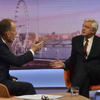 Former British Brexit Secretary David Davis (right) appears on the Andrew Marr Show on BBC television in London on Sunday. | REUTERS