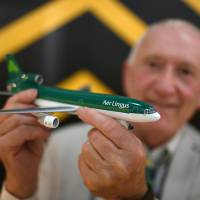 Michael Kelly holds a Lockheed Martin Tristar 500, an Aer Lingus model aircraft that is part of his collection, the world's largest, of diecast model aircraft unveiled at Shannon airport in Shannon, Ireland, Tuesday. | REUTERS