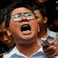 Reuters journalist Wa Lone leaves after listening to the verdict at a court in Yangon on Monday. | REUTERS