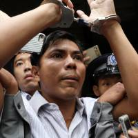 Reuters journalist Kyaw Soe Oo leaves after listening to the verdict at a court in Yangon on Monday. | REUTERS