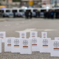 Numerous editions of the Federal Constitutional Law (Grundgesetz) are placed in the treet by supporters of the alliance Chemnitz Nazifrei' (Chemnitz without Nazis) close to the place of a countermarch in Chemnitz, eastern Germany, on Saturday ahead a protest of the far-right Alternative for Germany (AfD) party and anti-Islam Pegida movement. The far-right demonstration was organised in a reaction to a knife killing, allegedly by an Iraqi and a Syrian, that set off anti-immigrant mob violence. | MONIKA SKOLIMOWSKA / DPA / VIA AFP-JIJI