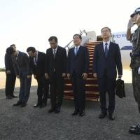 South Korean national security chief Chung Eui-yong (third from right); Suh Hoon (fourth from right), the head of the South's National Intelligence Service; and other officials pose before boarding an aircraft bound for Pyongyang, at a military airport in Seongnam, south of Seoul, on Wednesday. | POOL / VIA AP