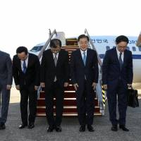 A South Korean special delegation led by national security chief Chung Eui-yong (second from right), leaves for Pyongyang from an airport in Sungnam, South Korea, on Wednesday. | REUTERS