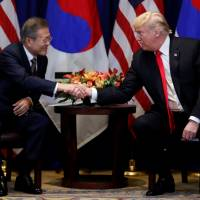 U.S. President Donald Trump shakes hands with South Korean leader Moon Jae-in as they hold a bilateral meeting on the sidelines of the United Nations General Assembly in New York on Monday. | REUTERS