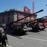 Self-propelled artillery roll past during a military parade marking the 70th anniversary of North Korea's foundation in Pyongyang on Sunday. | REUTERS