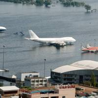 Aircraft are seen on flooded tarmac at the Don Muang airport in Bangkok in 2011, when the year's monsoon season brought the worst floods in decades and submerged a fifth of the city. As Bangkok hosts climate change talks from Sept. 4, 2018, the sprawling city of more than 10 million faces dire forecasts that it could be partially submerged in just over a decade. | AFP-JIJI
