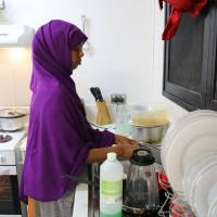 A refugee from Somalia does kitchen chores at refugee camp No. 5 on the Pacific island of Nauru on Sept. 2. | AFP-JIJI