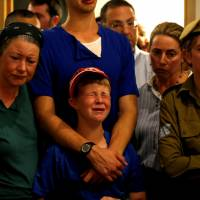 Relatives and friends mourn during the funeral of Ari Fuld, 45, an American-born Jewish settler fatally stabbed by a Palestinian, at a cemetery in Kfar Etzion in the occupied West Bank Sunday. | REUTERS