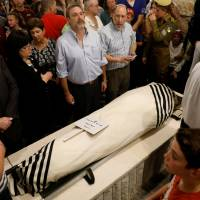 Relatives and friends mourn during the funeral of Ari Fuld, 45, an American-born Jewish settler fatally stabbed by a Palestinian, at a cemetery in Kfar Etzion in the occupied West Bank Monday. | REUTERS