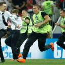 Stewards chase a pitch invader, later identified as member of the Pussy Riot punk group Pyotr Verzilov (left), during the Russia 2018 World Cup final soccer match between France and Croatia at the Luzhniki Stadium in Moscow in July. Verzilov was the victim of suspected poisoning with unknown substances but is now out of danger, his German doctors said on Tuesday.