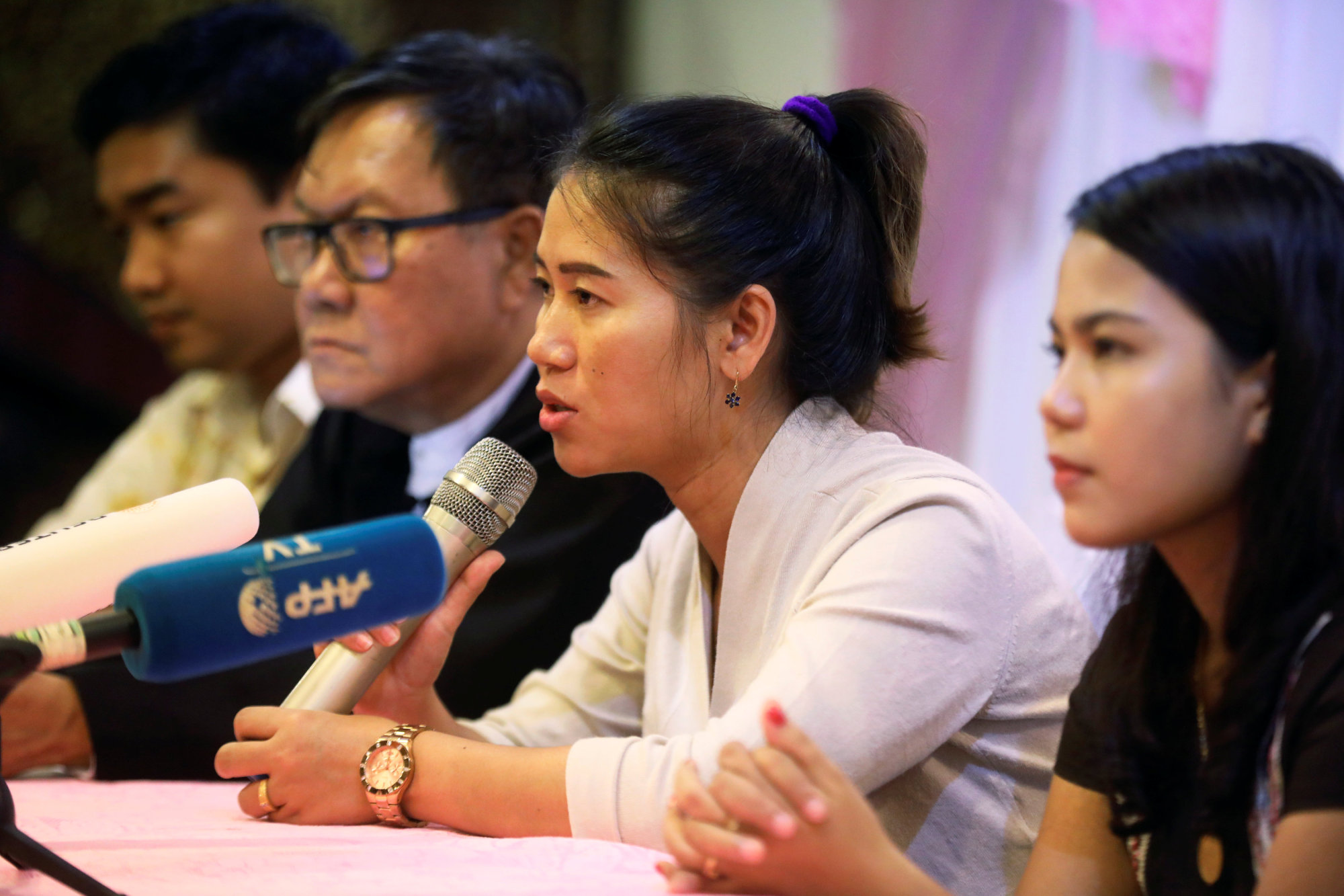 Pan Ei Mon, wife of Reuters journalist Wa Lone, talks to reporters during a family and lawyers press conference in Yangon Tuesday. | REUTERS