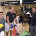 Australian filmmaker James Ricketson walks with his daughter, Roxanne Holmes, after his arrival at Sydney International Airport on Sunday.