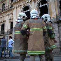 Bone fragments found in gutted, smoldering Rio museum provide some hope