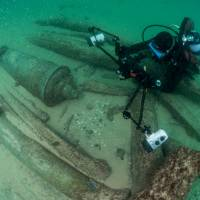Divers are seen during the discovery of a centuries-old shipwreck, in Cascais, Portugal, in this handout photo released Monday. | AUGUSTO SALGADO / CASCAIS CITY HALL / HANDOUT / VIA REUTERS
