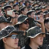 South Korea students gain weight 'to dodge military service'