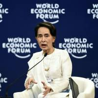 Myanmar State Counselor Aung San Suu Kyi speaks at the World Economic Forum on ASEAN in Hanoi on Thursday. | AFP-JIJI