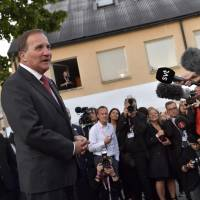 Swedish Prime Minister Stefan Lofven talks to the media at the Social Democratic Party's election wake in Stockholm on Sunday. Sweden's Social Democrats are tipped to be the country's biggest party after Sunday's election, with the far-right Sweden Democrats trailing in third place, a TV4 exit poll predicted shortly before polling stations closed. | JONAS EKSTROMER / TT NEWS AGENCY / VIA AFP-JIJI