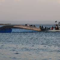 Investigators work on the capsized ferry MV Nyerere in Lake Victoria, Tanzania, on Friday. | AFP-JIJI