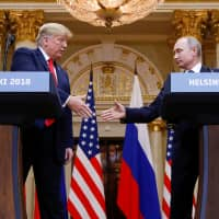 U.S. President Donald Trump and Russian President Vladimir Putin hold a news conference after meeting in Helsinki in July. | REUTERS