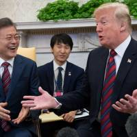 U.S. President Donald Trump gestures in a meeting with South Korean President Moon Jae-in  in the Oval Office of the White House in Washington in May. Trump agreed on Tuesday to meet with Moon on the sidelines of the U.N. General Assembly later this month in New York, the White House said. | AFP-JIJI
