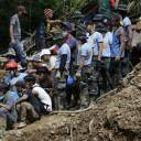 Rescuers watch as a body is recovered on Tuesday from a landslide set off by Typhoon Mangkhut in Itogon in the northern Philippines.