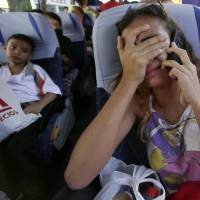 Diplomats meet over Venezuela migrant crisis as tens of thousands continue to flee
