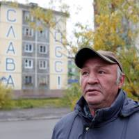 In polluted city above Russian Arctic Circle, prisoners of Putin's pension reform