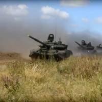 In this photo taken from video provided by Russian Defense Ministry Press Service on Tuesday, tanks roll during the military exercises in the Chita region, Eastern Siberia, during the Vostok 2018 exercises in Russia. | RUSSIAN DEFENSE MINISTRY PRESS SERVICE POOL PHOTO / VIA AP