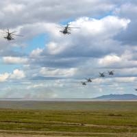 In this photo provided by Russian Defense Ministry Press Service on Tuesday, Russian military helicopters fly in the Chita region, Eastern Siberia, during the Vostok 2018 exercises in Russia. | RUSSIAN DEFENSE MINISTRY PRESS SERVICE POOL PHOTO / VIA AP