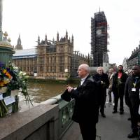 Members of the public pay their respects on Westminster Bridge on March 22 on the anniversary of the terror attack in London. | REUTERS